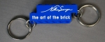 nathan sawaya art of the brick keychain blue with white text