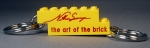 Nathan Sawaya The Art of the Brick Yellow 2x6 keychain with red text