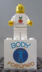 "Mini-Fig for the NC FLL Team ""The Smartians"" and 1x2x3 white brick printed with the  2010 ""Body Forward"" Challenge Logo"